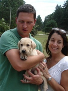 Clients with their new Labrador Retriever