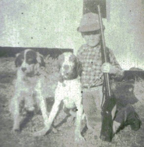 Woody as child with his dogs