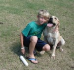 Boy with yellow Labrador Retriever