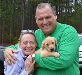 Two of our satisfied clients with their new puppy