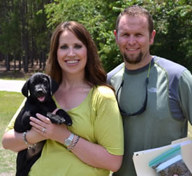 Another happy couple with their beautiful new puppy.