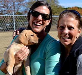Happy owners of a Twin Lakes Kennel puppy