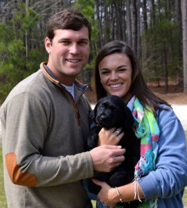 Young couple with their new puppy from Twin Lakes Kennel