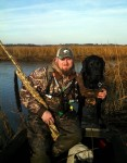 Ted with his black Labrador retriever Smoke