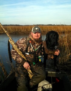Ted with his black Labrador retriever Smoke